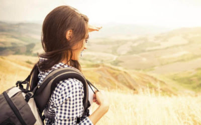 Young woman looking far into the valley.