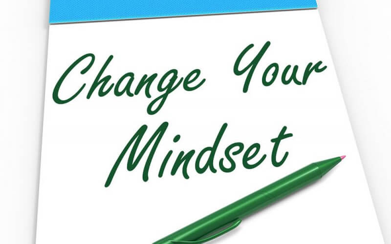 Paper with wording that says change your mindset with a green pen