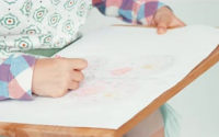 Child drawing and being creative