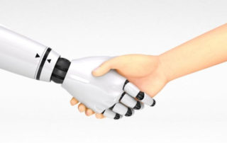 Person shaking hands with a robot